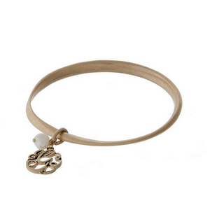 Burnished gold tone twist bangle with a script 'G' initial and freshwater pearl charms.