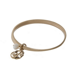 Burnished gold tone twist bangle with a script 'T' initial and freshwater pearl charms.