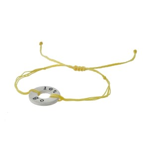 "Yellow cord, adjustable bracelet with a silver tone disc stamped with ""let go."""