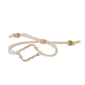 Ivory suede adjustable bracelet with a gold tone quatrefoil cutout.