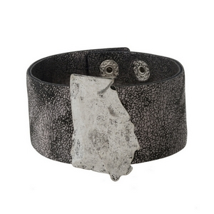"""Gunmetal, faux leather snap bracelet with a hammered silver tone state of Georgia. Approximately 1.5"""" in width."""