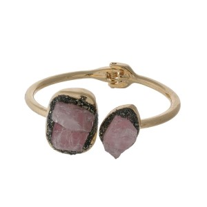 Gold tone hinge bangle bracelet with pyrite and pink stones.