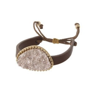 Brown faux leather adjustable bracelet with a rose gold faux druzy focal.
