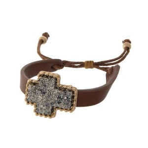 Brown faux leather adjustable bracelet with a gray faux druzy cross focal.