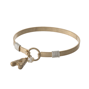 Gold tone bangle bracelet with a hook closure, a block 'A' charm, and a pearl bead accent.