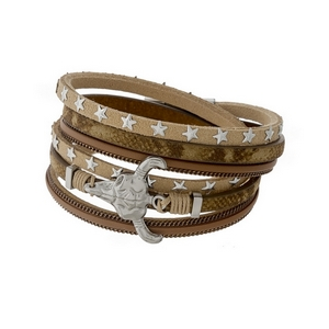 Silver tone wrap bracelet with gold tone accents and a steer head focal.