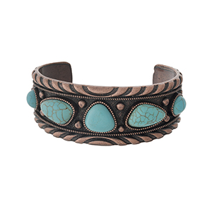Copper tone cuff bracelet with turquoise stones.