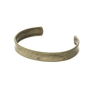 Hammered gold tone cuff bracelet.