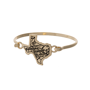 Gold tone bangle bracelet with the city map of College Station, Texas stamped on the state shape.