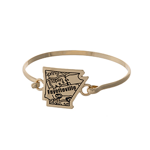 Gold tone bangle bracelet with the city map of Fayetteville, Arkansas stamped on the state shape.
