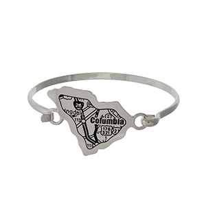 Silver tone bangle bracelet with the city map of Columbia, South Carolina stamped on the state shape.