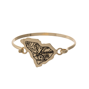 Gold tone bangle bracelet with the city map of Clemson, South Carolina stamped on the state shape.