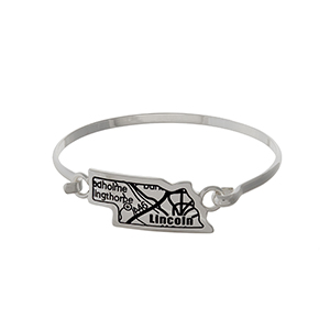 Silver tone bangle bracelet with the city map of Lincoln, Nebraska stamped on the focal.