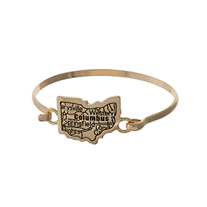 Gold tone bangle bracelet with the city map of Columbus, Ohio stamped on the focal.