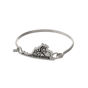 Silver tone bangle bracelet with the city map of Blacksburg, Virginia stamped on the state shape.