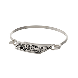 Silver tone bangle bracelet with the city map of Knoxville, Tennessee stamped on the state shape.