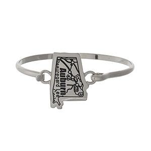 Silver tone bangle bracelet with the city map of Auburn, Alabama stamped on the state shape.