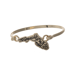 Gold tone bangle bracelet with the city map of Tallahassee, Florida stamped on the state shape.