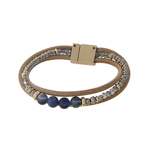 Brown leather cord bracelet with navy blue stones and a magnetic closure.