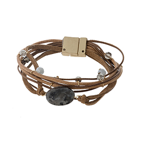 Brown cord bracelet with a gray semi-precious stone and a magnetic closure.