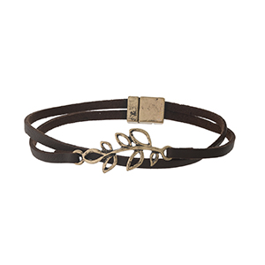 Brown faux leather magnetic bracelet with a gold tone leaf focal.