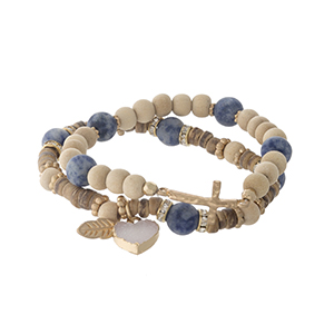 Two piece beaded stretch bracelet set with sodalite beads, a heart druzy charm and a gold tone cross.