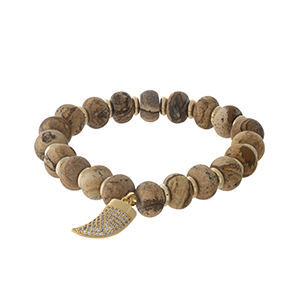 Picture jasper, natural stone beaded stretch bracelet with gold tone accents and a small horn charm. Handmade in the USA.