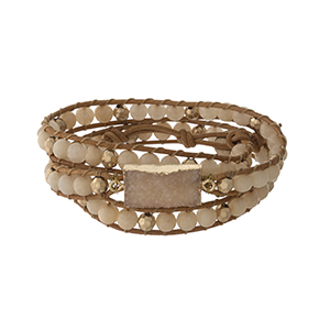 Beige beaded wrap bracelet with a druzy stone focal and a button closure.