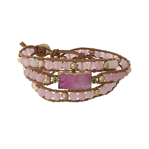 Pink beaded wrap bracelet with a druzy stone focal and a button closure.