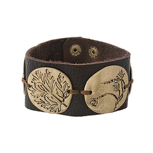 Brown leather snap bracelet with gold tone circles, stamped with leaf shapes.