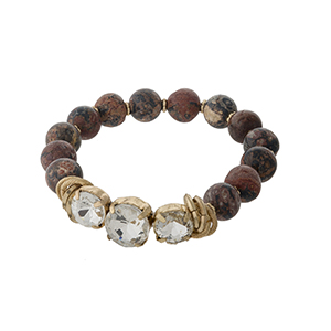 Rhodonite, natural stone beaded stretch bracelet with clear rhinestones and gold tone accents.