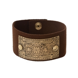 Brown faux leather snap bracelet with a hammered and stamped gold tone focal.