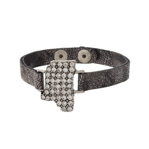 Gunmetal gray, faux leather snap bracelet with the state shape of Mississippi, accented by clear rhinestones.