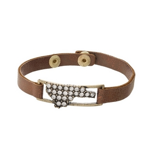 Bronze faux leather snap bracelet with the state shape of North Carolina, accented by clear rhinestones.