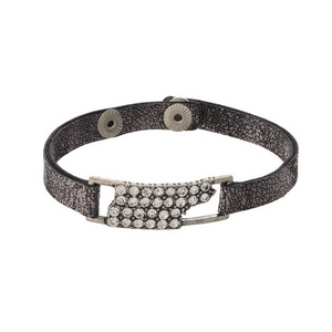 Gunmetal gray faux leather snap bracelet with the state shape of Tennessee, accented by clear rhinestones.