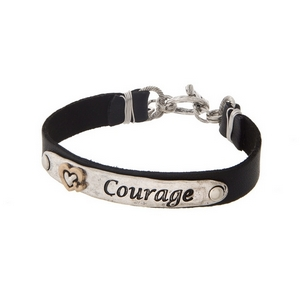 "Black and silver tone faux leather bracelet stamped with ""Courage."""