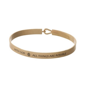 """Gold tone, brass bangle bracelet stamped with """"With God, All Things Are Possible."""""""