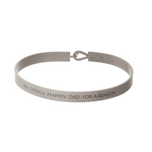 """Silver tone, brass bangle bracelet stamped with """"All Things Happen For A Reason."""""""