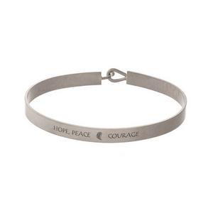 """Silver tone, brass bangle bracelet stamped with """"Hope Peace Courage."""""""