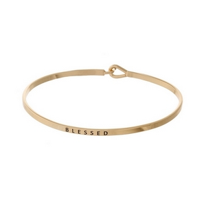"""Gold tone, brass bangle bracelet stamped with """"Blessed."""""""