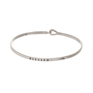 """Silver tone, brass bangle bracelet stamped with """"Blessed."""""""