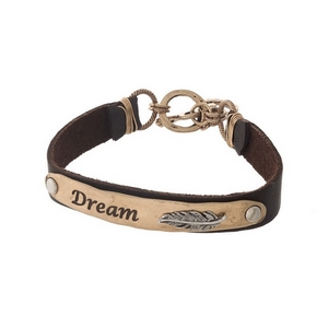 "Brown and gold tone faux leather bracelet stamped with ""Dream."""