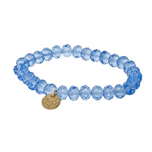 Light blue faceted bead stretch bracelet with a hammered gold tone circle charm.
