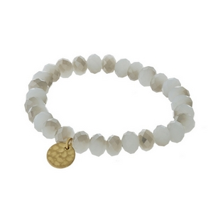 Opal and gray faceted bead stretch bracelet with a hammered gold tone circle charm.
