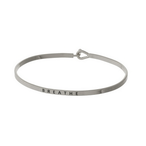 "Dainty silver tone bangle bracelet stamped with ""Breathe."""