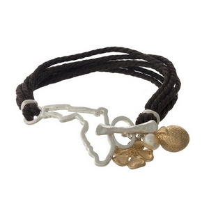 Brown braided cord bracelet with a silver tone shape of Florida focal, gold tone charms, and a toggle closure.