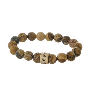 """Picture jasper, natural stone beaded stretch bracelet with a gold tone bead, stamped with """"Believe."""""""
