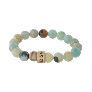 "Amazonite, natural stone beaded stretch bracelet with a gold tone bead, stamped with ""Blessed."""