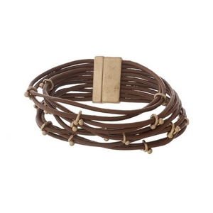 Brown, genuine leather magnetic bracelet with matte gold tone accents.