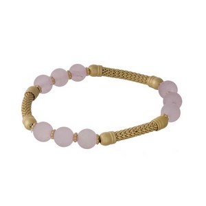 Gold tone stretch bracelet set featuring rose quartz natural stone beads.
